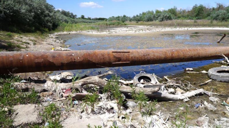 Участок Северо-Крымского канала под Армянском превращается в мусорную свалку (+фото)