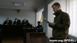Прокурор Станислав Фрунзе зачитывает ходатайство о продлении ареста Тараса Сынычаку