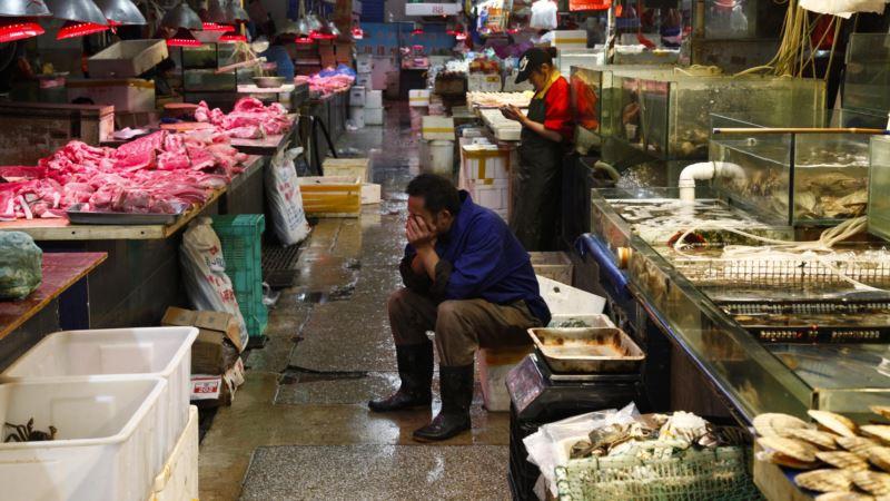 В районе рынка в Пекине ввели режим военного времени из-за вспышки коронавируса