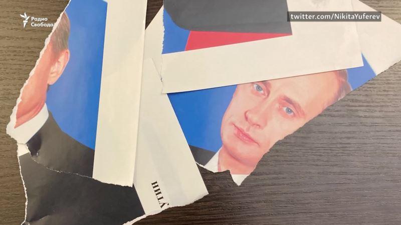 «Я вашего Путина тоже порву». Как российский депутат уничтожил портрет президента (видео)